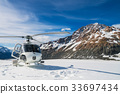 Helicopter Landing on a Snow Mountain 33697434