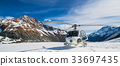 Helicopter Landing on a Snow Mountain 33697435