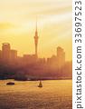 Golden sunset at Auckland city, New Zealand. 33697523