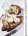 French goat cheese, milk and sourdough bread 33698497