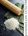 Green nori sheet , rice and bamboo mat. 33702798