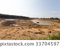 Mining in a sand quarry with powerful machines 33704597