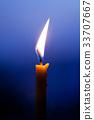 Closeup of burning candle 33707667