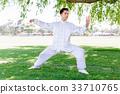 Handsome man practicing thai chi 33710765