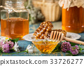 natural organic honey  on rustic  table 33726277