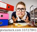 Depressed businesswoman sitting at desk 33727841