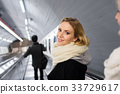 Young woman standing at the escalator in Vienna 33729617