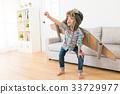 smiling female children wearing astronaut costume 33729977