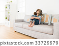 youth little girl sitting on living room couch 33729979