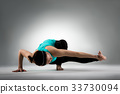 professional fitness coach woman doing yoga posing 33730094