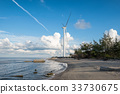 Wind turbines generators on shore of sea 33730675