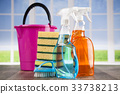 House cleaning product on wood table and window  33738213