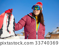 Happy young snowboard girl on the snow sunny day 33740369