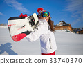 Happy young snowboard girl on the snow sunny day 33740370