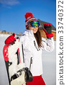 Happy young snowboard girl on the snow sunny day 33740372