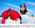 Happy young snowboard girl on the snow sunny day 33740373