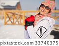 Happy young snowboard girl on the snow sunny day 33740375
