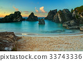 A calm, tropical beach and sea at sunrise 33743336