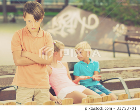Portrait of boy 8-11 years old which is taking offense on his friends 33753701