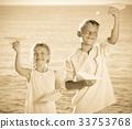 two kids planes beach 33753768