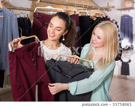Young women shopping pants 33758065