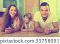 Happy couple with child at home 33758091
