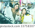 Family enjoying purchases in shop 33758307