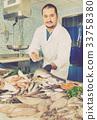 counter, man, fish 33758380