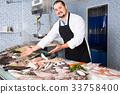 standing, man, fish 33758400