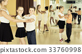 Little boys and girls having dancing class in classroom 33760998