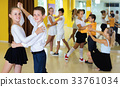 Little boys and girls having dancing class in classroom 33761034