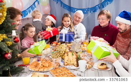 Family exchanging Christmas gifts 33761063