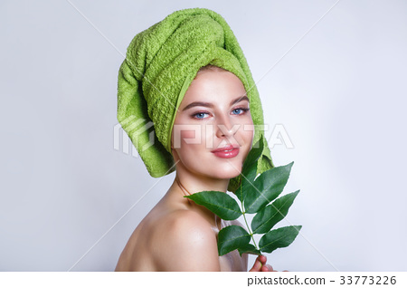 young beautiful woman with green towel on her head 33773226
