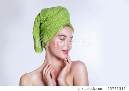 beautiful young woman with green bath towel 33773315