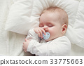 Baby sleeping covered with soft blanket 33775663