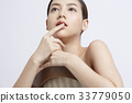 portrait of young beautiful woman touching her lip and thinking 33779050