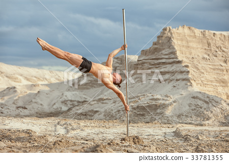Acrobatics on the pole. 33781355