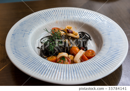 Italian black spaghetti with seafood and tomato,  33784141