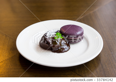 Chocolate lava cake with macaroon and peppermint  33784142