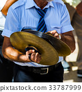 musician plays the cymbals  33787999