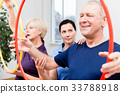 Senior couple in physiotherapy doing exercise with 33788918