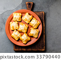 Mini chilean empanadas on clay plate with typical 33790440