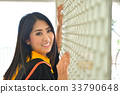 Asian cute women portrait graduation. 33790648