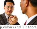 Arm wrestling of business people 33812774