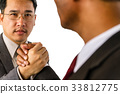 Arm wrestling of business people  33812775