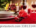 Christmas dishware on the table 33813144