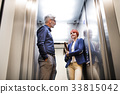 Business people in the elevator in modern office 33815042