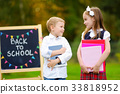 Two adorable little schoolkids feeling exited about going back to school 33818952