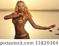 Beautiful blonde belly dancer 33820364