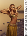 Beautiful blonde belly dancer 33820367
